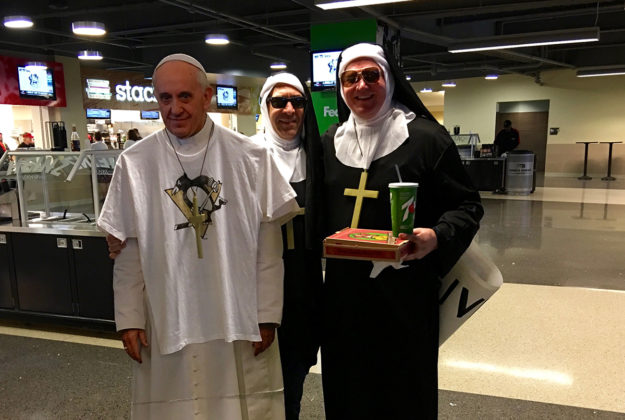 penguins fans with pope cutout