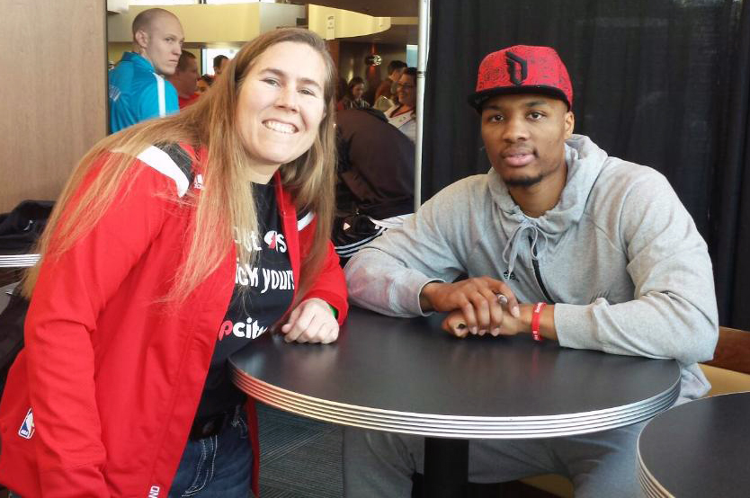 Mika with her favorite player, Damian Lillard.